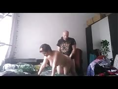Bald man fucks a fatty busty woman in the doggy style