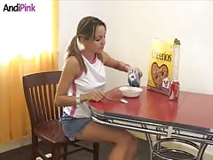 18 yo Andi Pink is eating corn flakes in the morning
