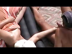 Girl Jerks Off guy dick on public beach and he cums on plaid