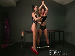 BDSM XXX Slave boy in metal stocks as he receives anal