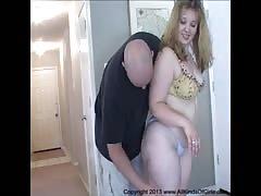 Curvy blonde kneels down and takes a juicy wiener