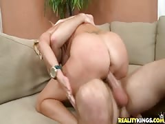 Big-breasted woman is taking juicy dick in her wide mouth