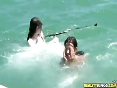 An awesome babe is giving a good blowjob in the sea