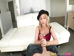 Stunning blonde slut in black hat is sucking his horny dick